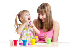 Happy kid and mother play clay toy Royalty Free Stock Photography