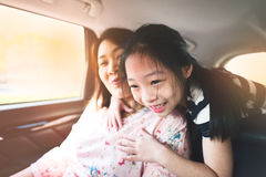 Happy kid and mother  travelling in car.. Stock Image