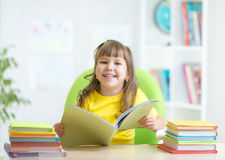 Happy kid with opened book Royalty Free Stock Photography