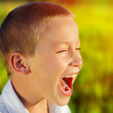 Happy Kid outdoor. Toned photo of Kid Yell outdoor Stock Photography
