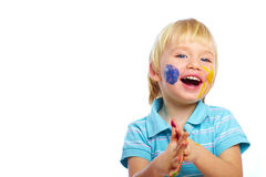Happy kid with paints on face Royalty Free Stock Image