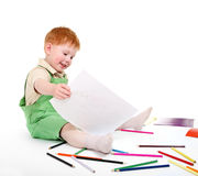 Happy kid with pencils Stock Image