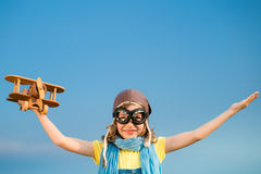 Happy kid playing with airplane outdoors Royalty Free Stock Photo