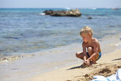 Happy kid playing on a beach Royalty Free Stock Image