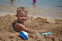 Happy kid playing on a beach Royalty Free Stock Images