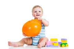 Happy kid playing with building blocks toy. Kid boy playing with building blocks toy stock photo