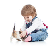 Happy kid playing with cat kitten. Happy child playing with cat kitten stock images