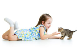 Happy kid playing with cat kitten Stock Photo