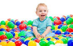 Happy kid playing colorful balls Stock Image