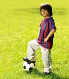 Happy kid playing football Stock Images