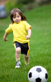 Happy kid playing football Royalty Free Stock Photo