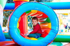 Happy kid playing on inflatable attraction playground Royalty Free Stock Photography