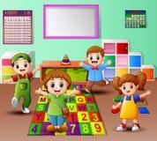 Happy kid playing in the kindergarten classroom Stock Images
