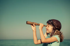 Happy kid playing outdoor against sea and sky Royalty Free Stock Images