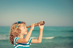 Happy kid playing outdoor against sea and sky Stock Photography