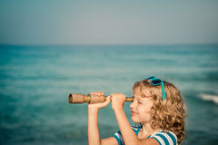 Happy kid playing outdoor against sea and sky Royalty Free Stock Photos