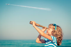 Happy kid playing outdoor against sea and sky Royalty Free Stock Photo