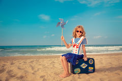 Happy kid playing outdoor against sea and sky Royalty Free Stock Photography