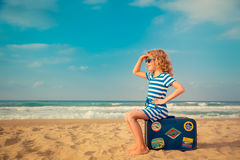 Happy kid playing outdoor against sea and sky Royalty Free Stock Image