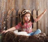 Happy kid playing in pilot helmet Royalty Free Stock Image