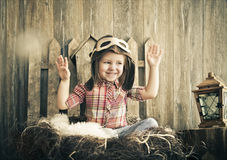 Happy kid playing in pilot helmet Stock Images