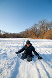 Happy kid playing in the snow Royalty Free Stock Photography