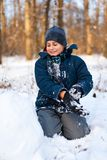 Happy kid playing in the snow Royalty Free Stock Images