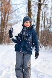 Happy kid playing in the snow Stock Photos