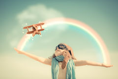 Happy kid playing with toy airplane royalty free stock image