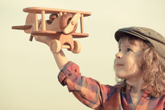 Happy kid playing with toy airplane Royalty Free Stock Photography