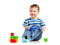 Happy kid playing toy blocks Royalty Free Stock Image