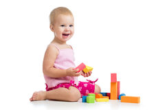Happy kid playing toy blocks Stock Photos