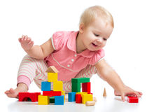 Happy kid playing toy blocks on white Royalty Free Stock Photos