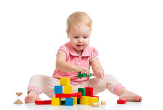Happy kid playing toy blocks on white Royalty Free Stock Images