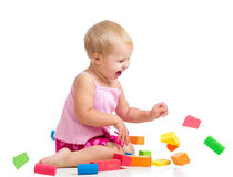 Happy kid playing toy blocks on white background Stock Image