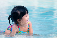 Happy kid playing in the water Stock Photos