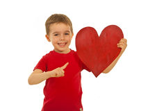 Happy kid pointing to heart shape Stock Photo