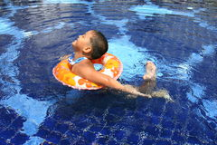Happy kid in the pool Stock Image