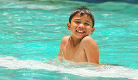 Happy kid on the pool Royalty Free Stock Images