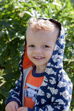 Happy kid. Portrait of smiling young boy with hooded sweatshirt Stock Photo
