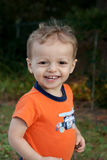 Happy kid. Portrait of a Young toddler boy in an orange short sleeve shirt Stock Images