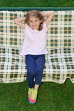 Happy kid posing swing garden chair Royalty Free Stock Photography