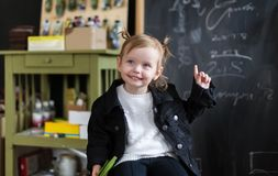Happy kid preschool girl is in creativity classroom. Concept of success.  stock photo