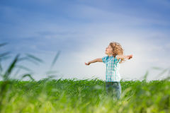 Happy kid with raised arms Royalty Free Stock Image