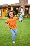 Happy kid running Royalty Free Stock Photos