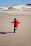 Happy kid running Royalty Free Stock Photography