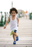 Happy kid running Royalty Free Stock Photo