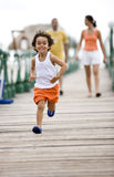 Happy kid running Stock Photo