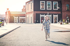 Happy kid is running Royalty Free Stock Photos