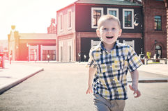 Happy kid is running Stock Photography